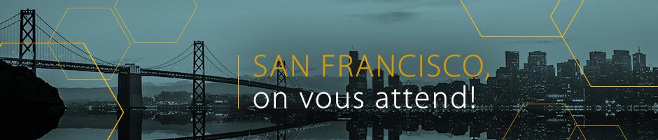 Photo de la ville, en noir et bleu, avec le texte San Francisco, on vous attend!